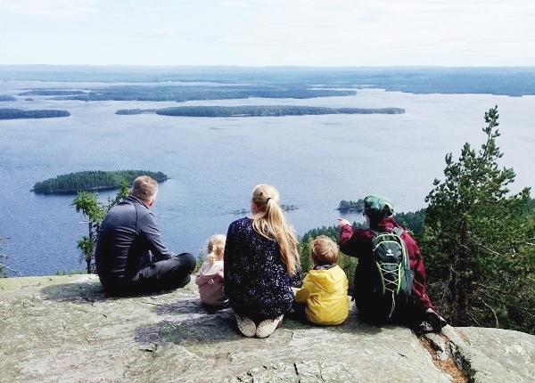 Image: Group admiring Lake Pielinen in Koli National Park.