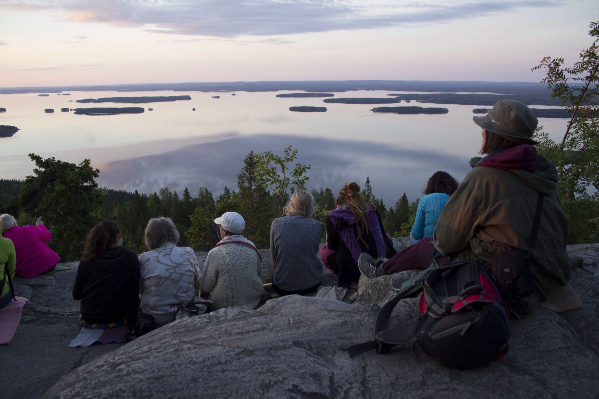 Image: Group of people watching sunset in Koli National Park.